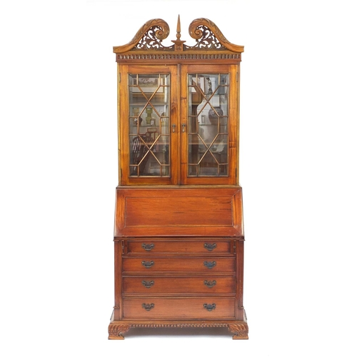 2022 - Mahogany bureau bookcase with a pair of astragal glazed doors, above a fall and four drawers on carv...