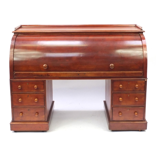 2037 - Mahogany twin pedestal cylinder bureau with fitted interior, pull out writing shelf and six drawers,...