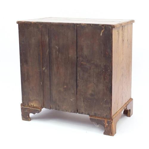 2019 - Antique walnut kneehole desk with quarter veneered top, cross banded and feather banded drawers abov...