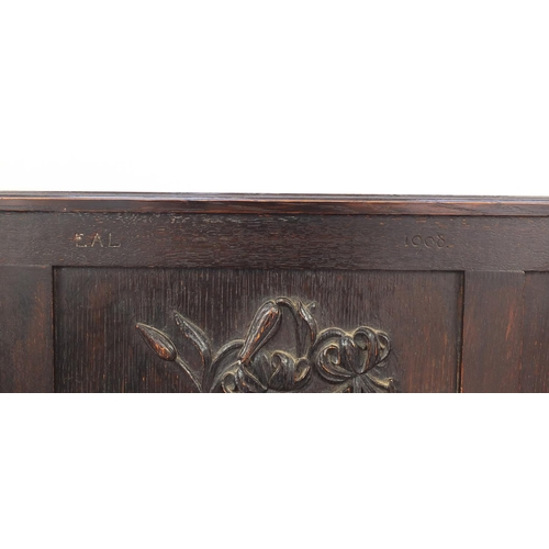 2023 - Oak Settle with floral carved panels and lift up seat, 122cm H x 123cm W x 46cm D...