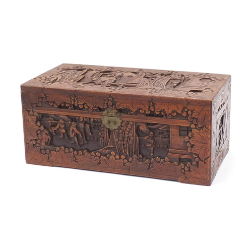 28 - Camphorwood chest carved with figures and buildings, 35cm H x 73cm W x 36cm D...