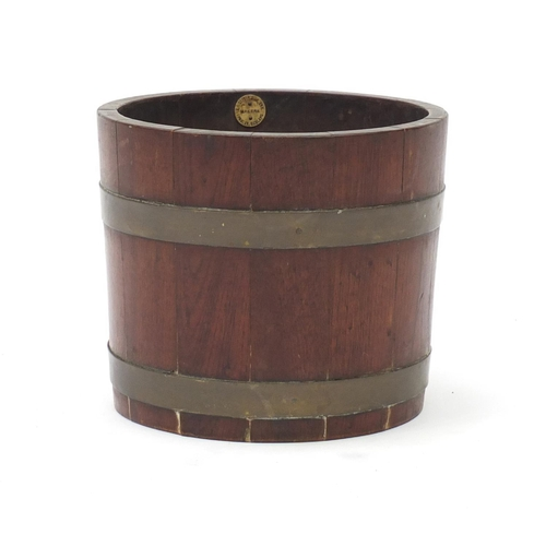 36 - Brass bound oak barrel planter with G A Lister & Co makers label, 22.5cm high x 26cm in diameter...