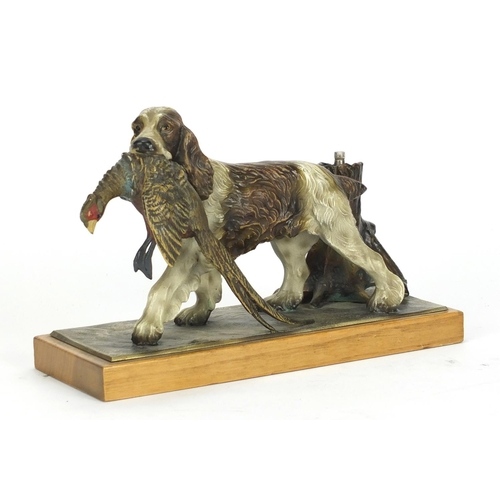 23 - Austrian cold painted table lighter in the form of a spaniel with its prey, 25cm wide...