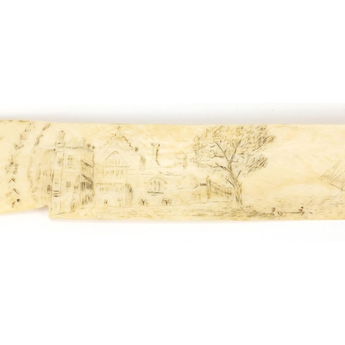 30 - Antique Scrimshaw ivory letter opener, decorated with a building beside water and a rigged ship, 37....