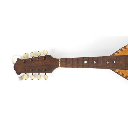 53 - 19th century Italian inlaid mandolin by D Brambilla, with paper label and case, 61cm in length...