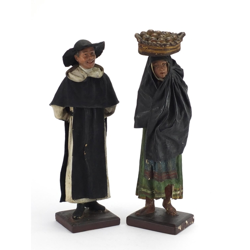 12 - Pair of carved wood and plaster figures of peasants, the largest 38.5cm high...