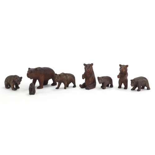 17 - Eight carved Black Forest bears, the largest 9.5cm in length...
