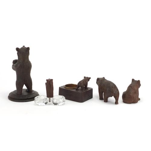 16 - Five carved Black Fores bears including an ashtray and salt, the largest 13.5cm high...