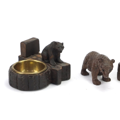 15 - Three carved Back Forest bears including two dishes, the largest 13cm high...