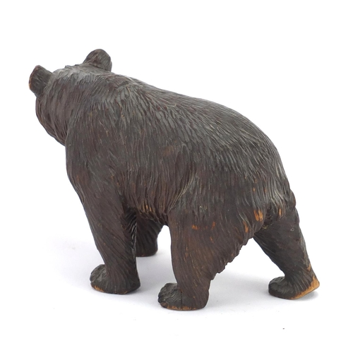 13 - Carved Black Forest standing bear with beaded glass eyes, 17cm in length...