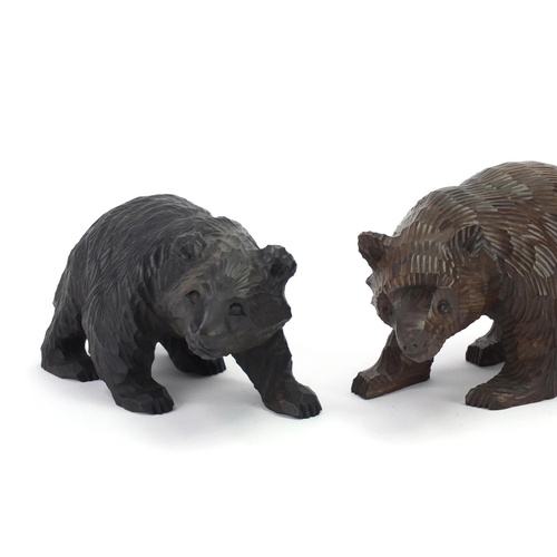 14 - Three carved Black Forest bears, the largest 20cm in length...