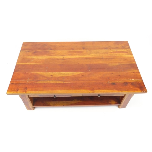 33 - Mexican pine coffee table with two drawers and under tier, 48cm H x 135cm W x 77cm D...