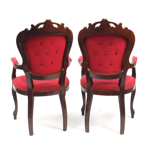 12 - Pair of French style mahogany open armchairs with red button back upholstery, 107cm high...