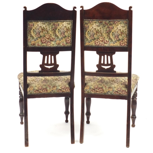 52 - Pair of Art Noveau mahogany side chairs with floral upholstery, 104cm high...