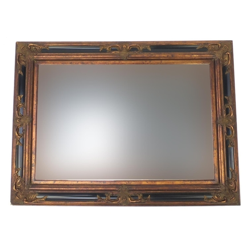 40 - Large rectangular wall hanging mirror with bevelled glass and black and gilt frame, 118cm x 86cm...