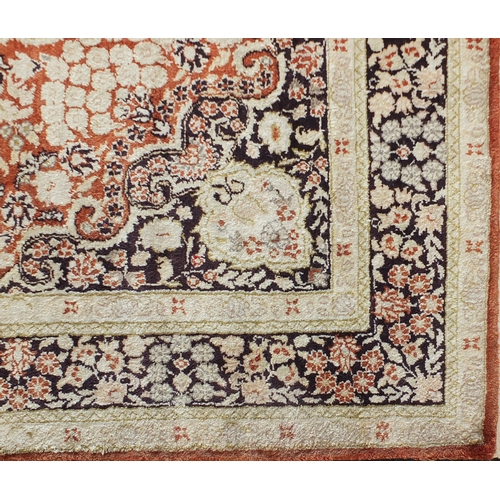 2013 - Fine Rectangular silk rug having all over stylised motifs within corresponding borders, onto a midni...