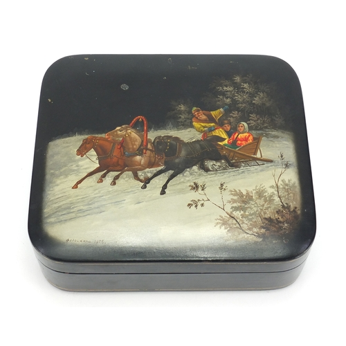 18A - Russian black lacquered box by Fedoskino, the hinged lid hand painted with figures in a sleigh, 6cm ...