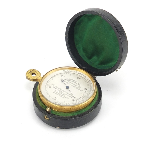 34 - 19th century gilt brass Hutchinson surveying aneroid pocket barometer, with fitted leather case, 5cm...