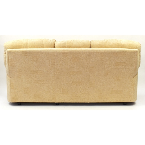 2054 - Beige upholstered three seater settee, 210cm wide...