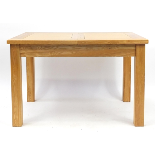 2028 - Contemporary light oak extending dining table with extra leaf and six chairs, the table 78cm H x 120...