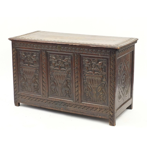2003 - Antique oak three panel coffer carved with vase and flowers, 68cm H x 115cm W x 52cm D...