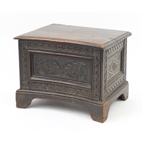 2027 - Antique carved oak box with foliate carved concave front panel, 43cm H x 56cm W x 45cm D...