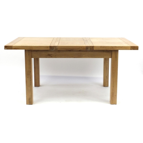 2002 - Contemporary light oak extending dining table, with folding leaf and four chairs, 79cm H x 167cm W (...