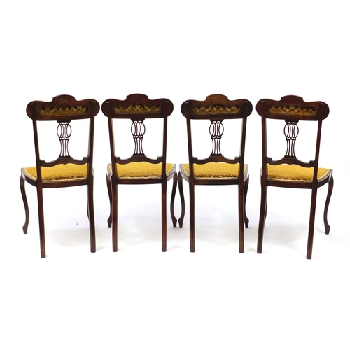 2039 - Set of four Edwardian mahogany salon chairs with gold floral upholstery...