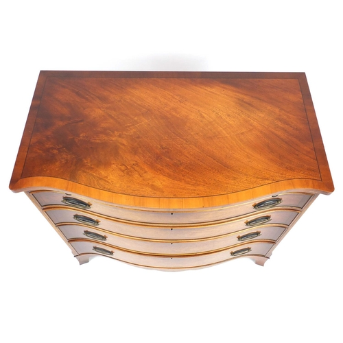 2005 - Good quality reproduction mahogany serpentine chest with yew wood banding and brushing slide above f...