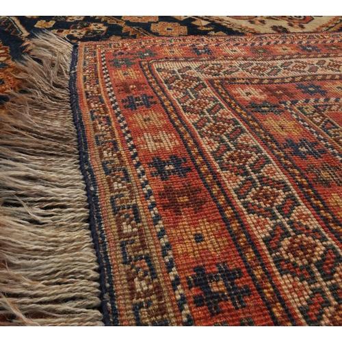 2014 - Rectangular Persian Kashgan rug, having and all over stylised design, 214cm x 138cm...
