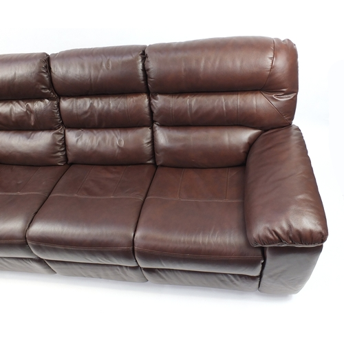 2010 - Brown leather electric reclining three seater  settee, 212cm wide...