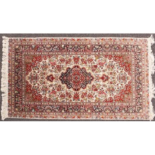 2006 - Fine rectangular silk rug having all over floral motifs, 155cm x 93cm...