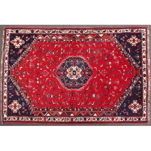 2050 - Persian Shriaz red and blue ground rug, decorated with birds and geometric design, 310cm x205cm...