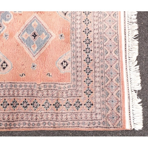 8 - Pink and blue ground rug with geometric design, 270cm x 180cm...