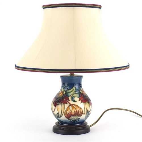 2053 - Moorcroft baluster vase lamp base with silk lined shade, hand painted with stylised flowers, overall...