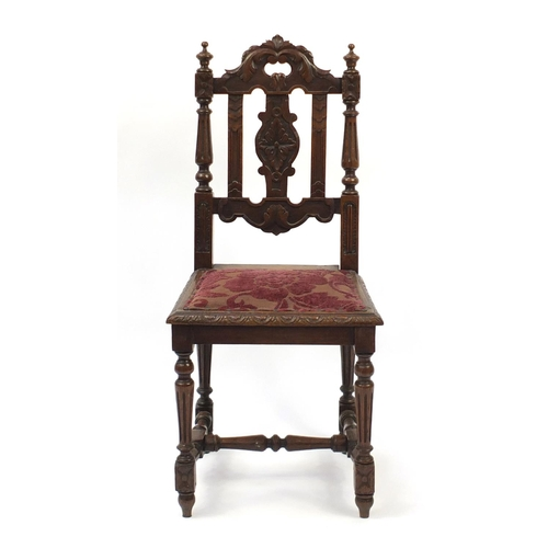 43 - Carved oak hall chair with fluted legs, 98cm high...