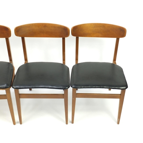 4 - Set of eight vintage teak chairs with black leatherette seats, in the style of Kofod Larsen, 76cm hi...
