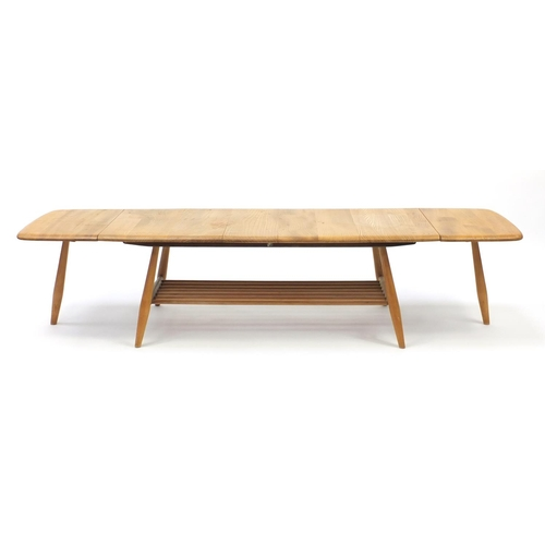 20 - Ercol light elm 456 drop leaf extending coffee table, 36cm H x 108cm W (folded) x 46cm D...