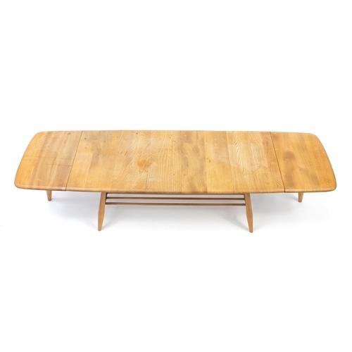 20 - Ercol light elm 456 drop leaf extending coffee table, 36cm H x 108cm W (folded) x 46cm D...