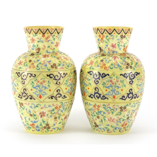 668 - Pair of 19th century yellow opaline glass vases, hand painted with stylised flowers and foliage, eac...