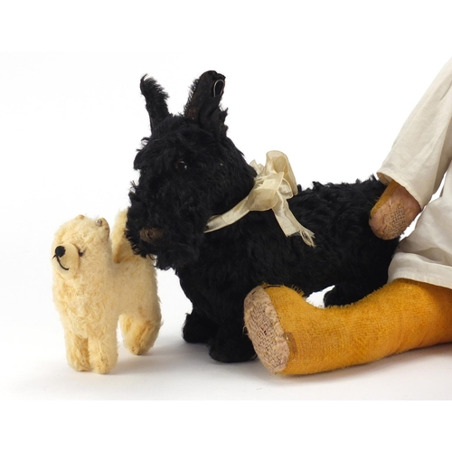 169 - Vintage toys including a golden straw filled bear and a Steiff dog, the largest 61cm in length...