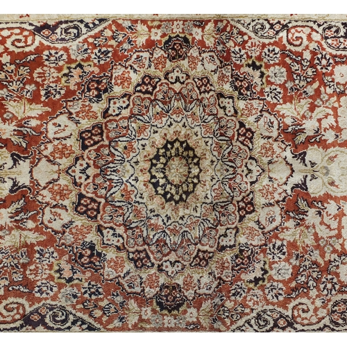 35 - Fine Rectangular silk rug having all over stylised motifs within corresponding borders, onto a midni...