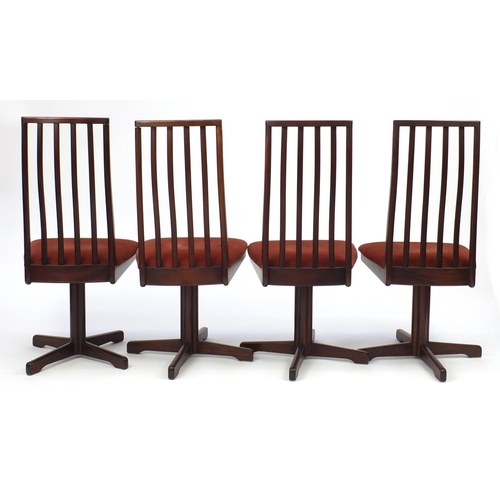 12 - Set of eight Vintage Rosewood swivel dining chairs, reputably retailed by Waring & Gillow, each 103c...
