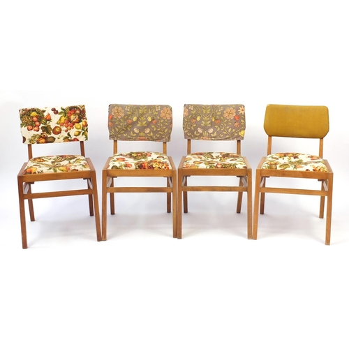 47 - Set of four lightwood Ben chairs with screen print upholstery...