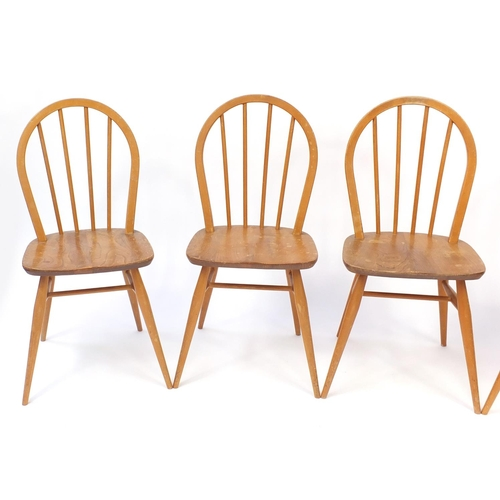 23 - Set of four Ercol light elm stick back chairs, 87cm high...