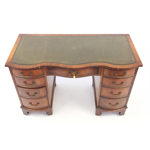 3 - Mahogany twin pedestal desk with serpentine front and tooled leather top, 76cm H x 115cm W x 54cm D...