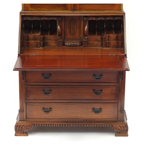 38 - Mahogany bureau bookcase with a pair of astragal glazed doors, above a fall and four drawers on carv...
