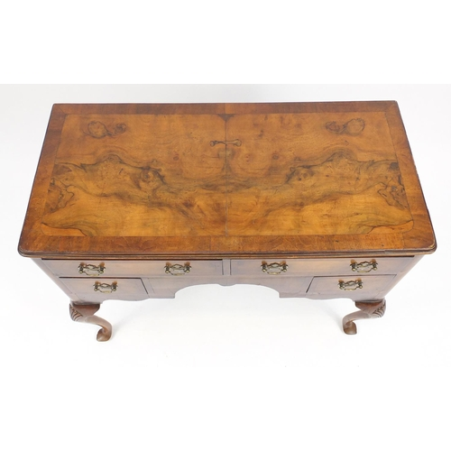 50 - Walnut and mahogany cross banded low boy, fitted with four drawers on shell carved cabriole legs, 80...