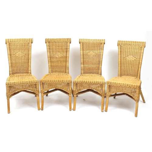 47A - Rattan and wrought iron conservatory table with four chairs...