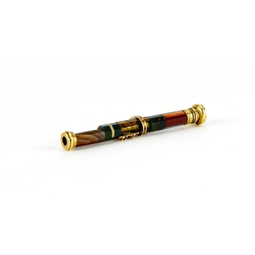 11 - 19th century unmarked gold and agate propelling pencil, 6.5cm in length when closed...